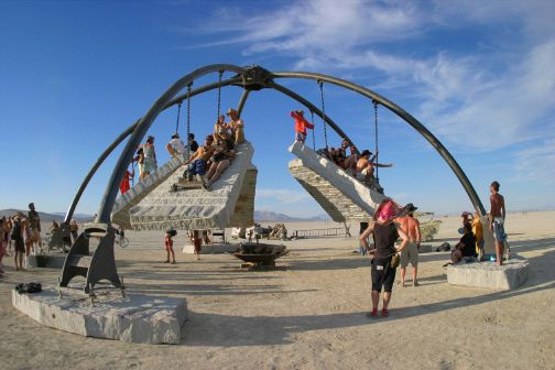 concrete burning man sculpture