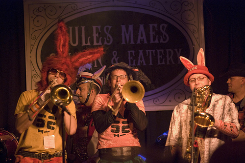 two trombones and baritone sax with bunny ears, rabbit band at honk festival seattle